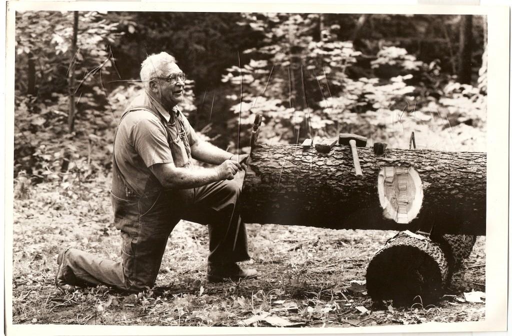 Lloyd Weddell  teaching log hewing at Bob Evan's Farm copy